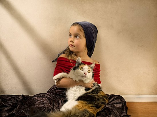 charming little girl; reckon the cat was much harder to pose than the child (image: bill gekas; courtesy gizmag)